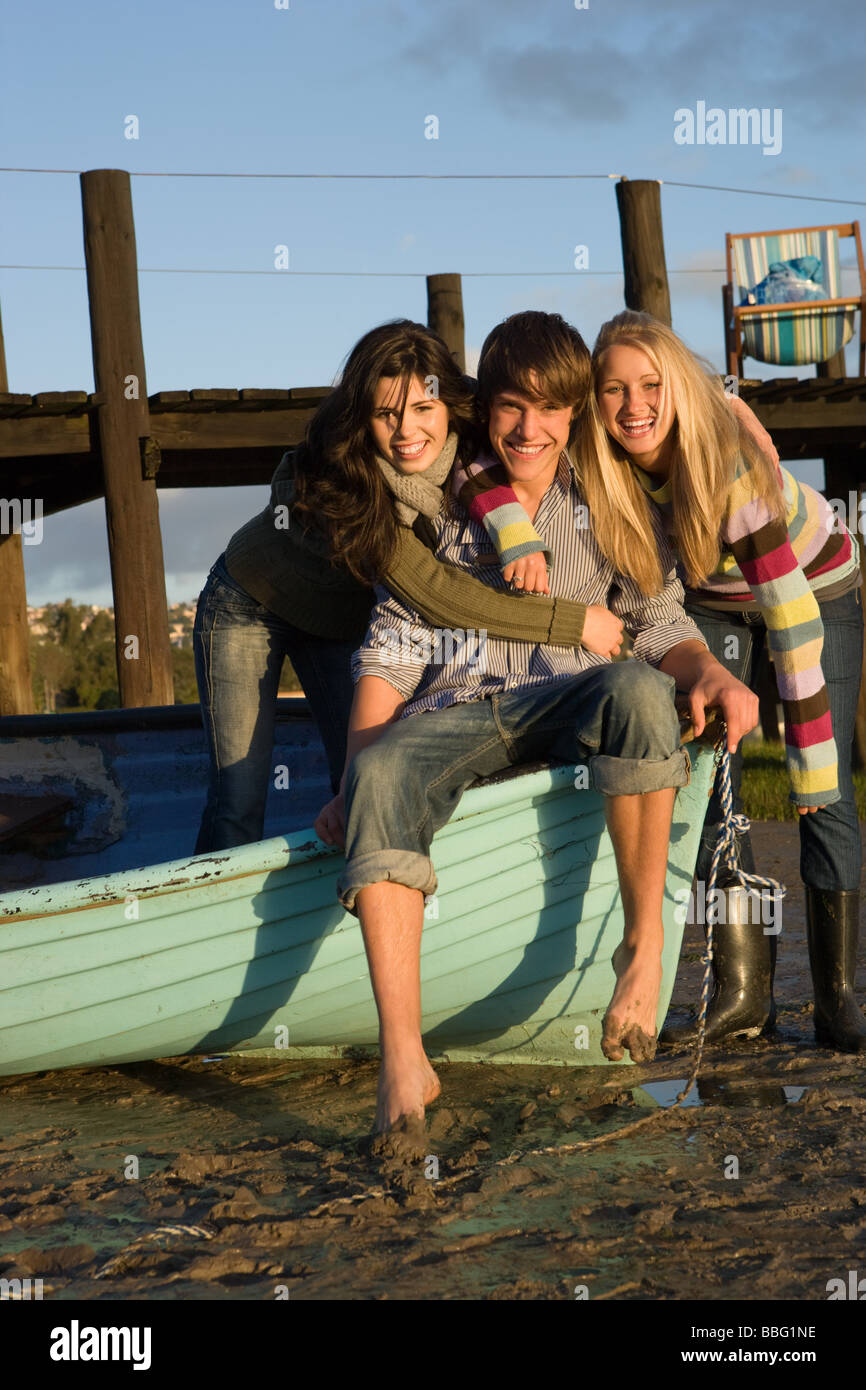 Friends with rowboat - Stock Image