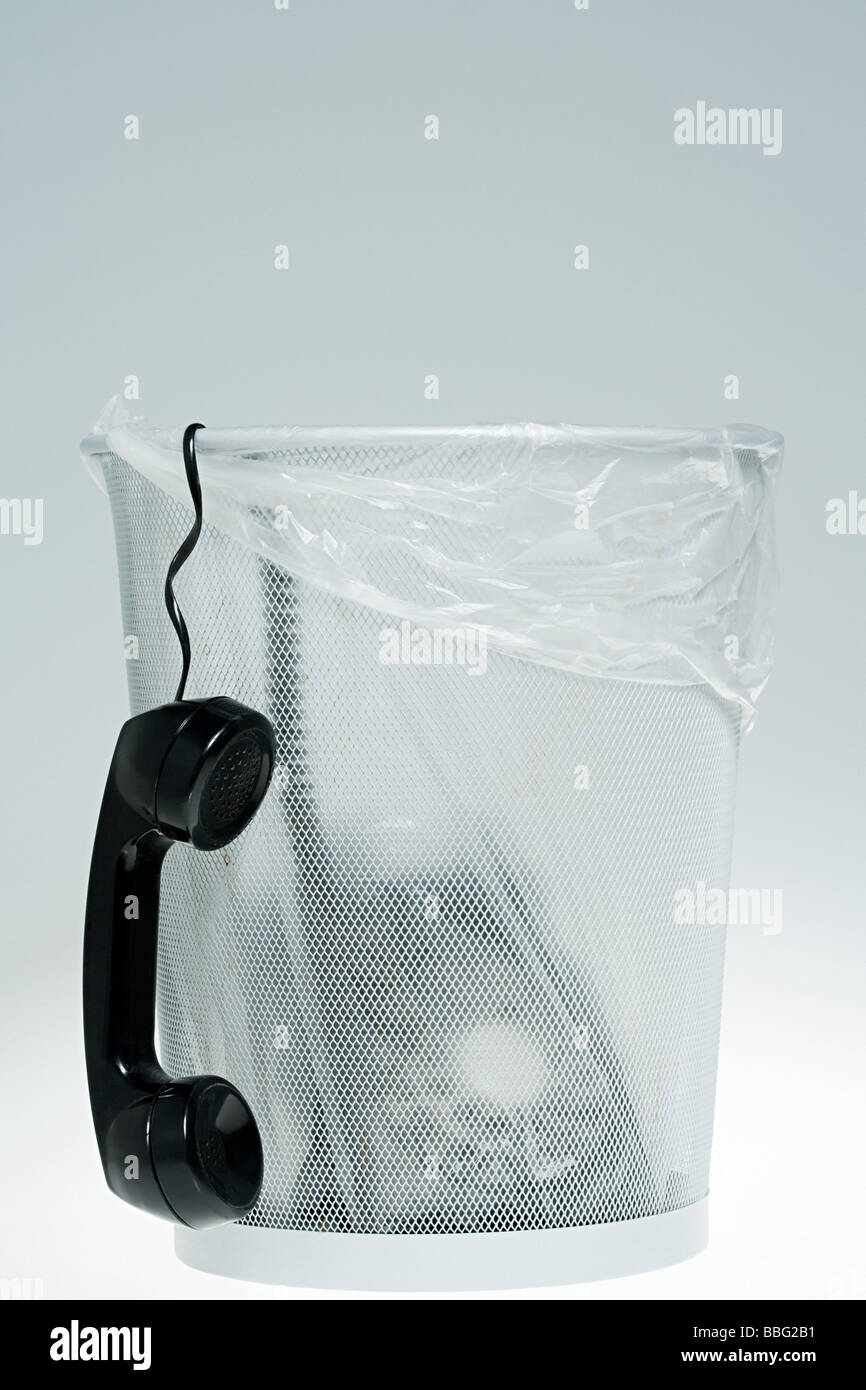 Telephone in a bin - Stock Image