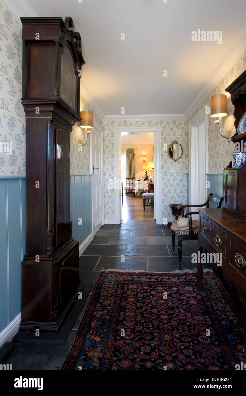 Hallway,hall,farmhouse,converted,old world,modern,new,grand father clock,reception,house - Stock Image