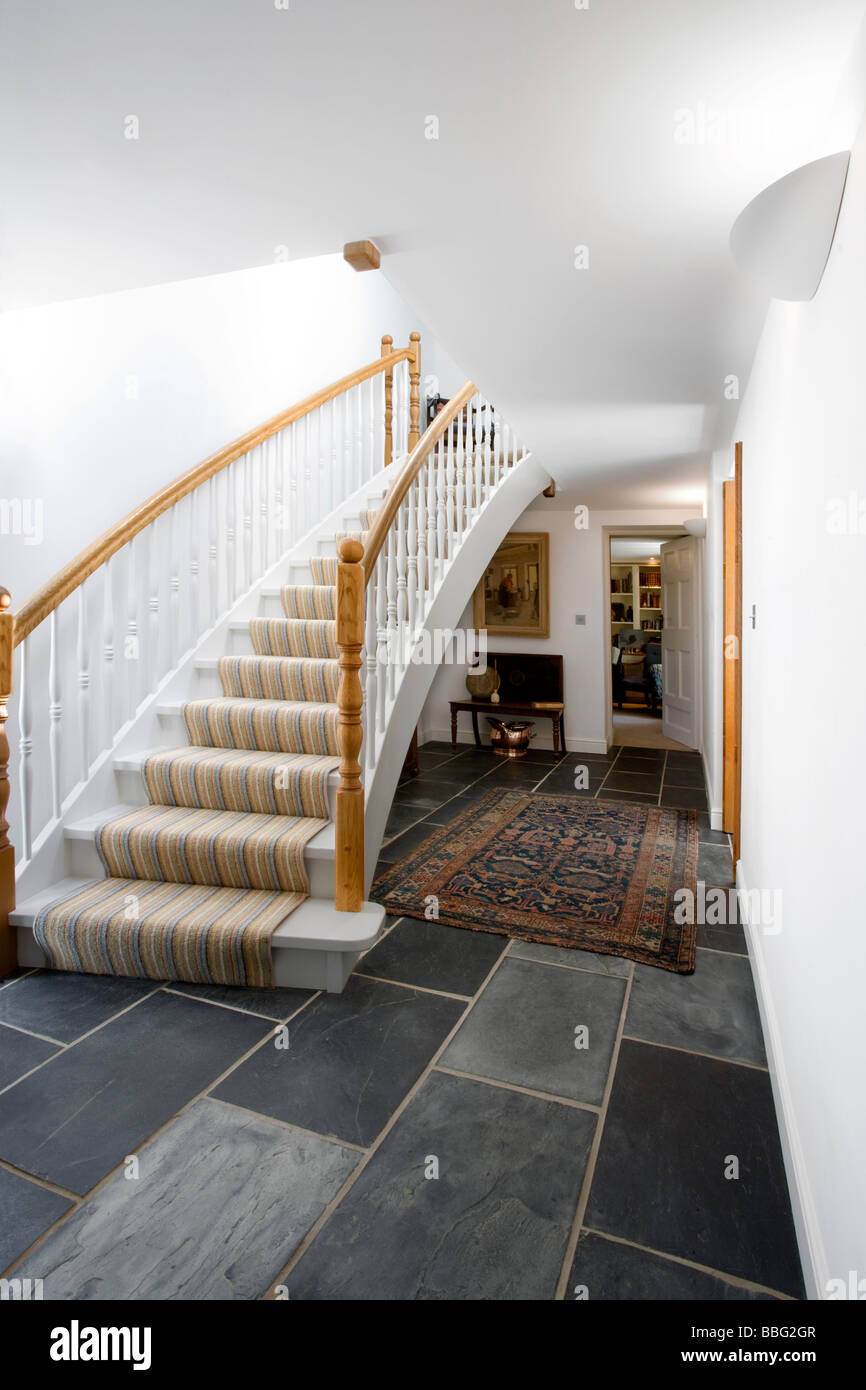 Staircase,stairs,landing,hall,hallway,entrance,tiled floor,house - Stock Image