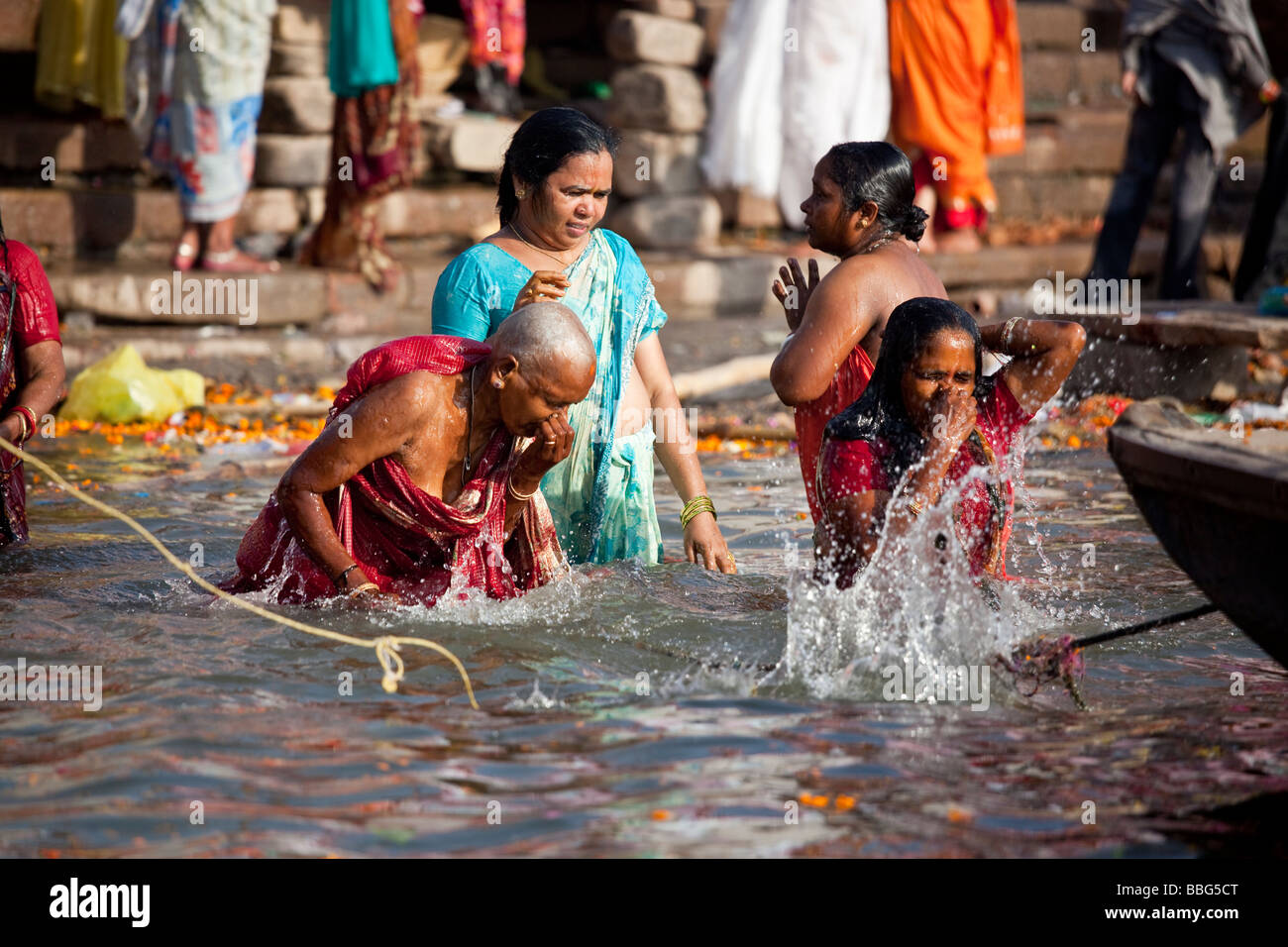 5388768c884 Bathing at Prayag Ghat in the Ganges River in Varanasi India - Stock Image