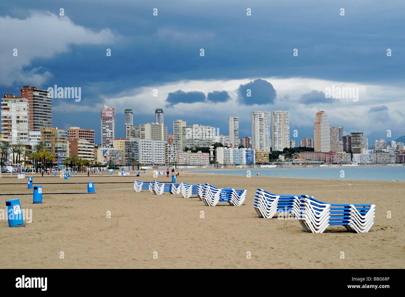 Empty beach, deck chairs, dark clouds, bad weather, crisis, Playa de Poniente, Ponent, beach, Benidorm, Costa Blanca, Stock Photo