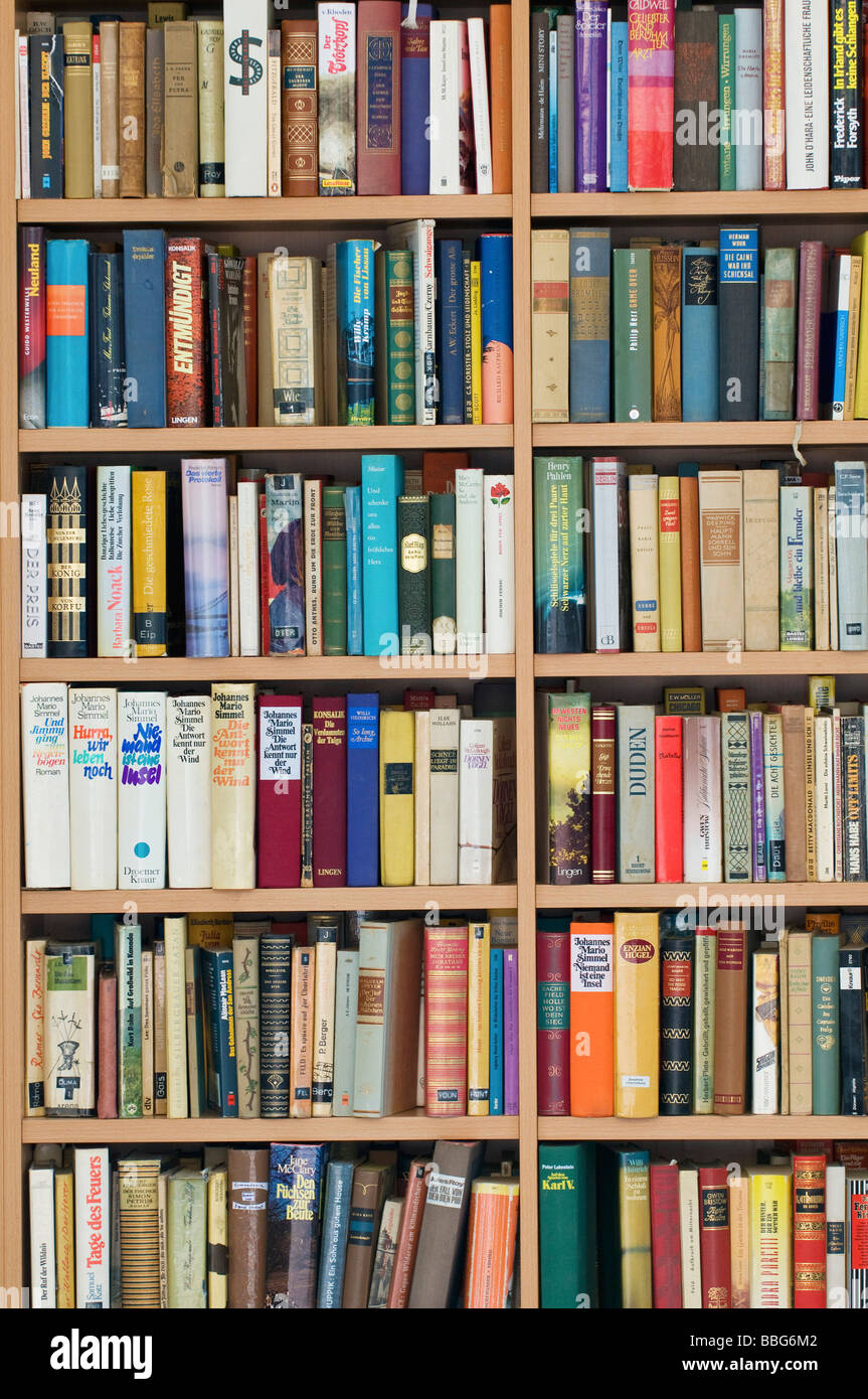 Full bookcase, second hand bookshop, fiction - Stock Image