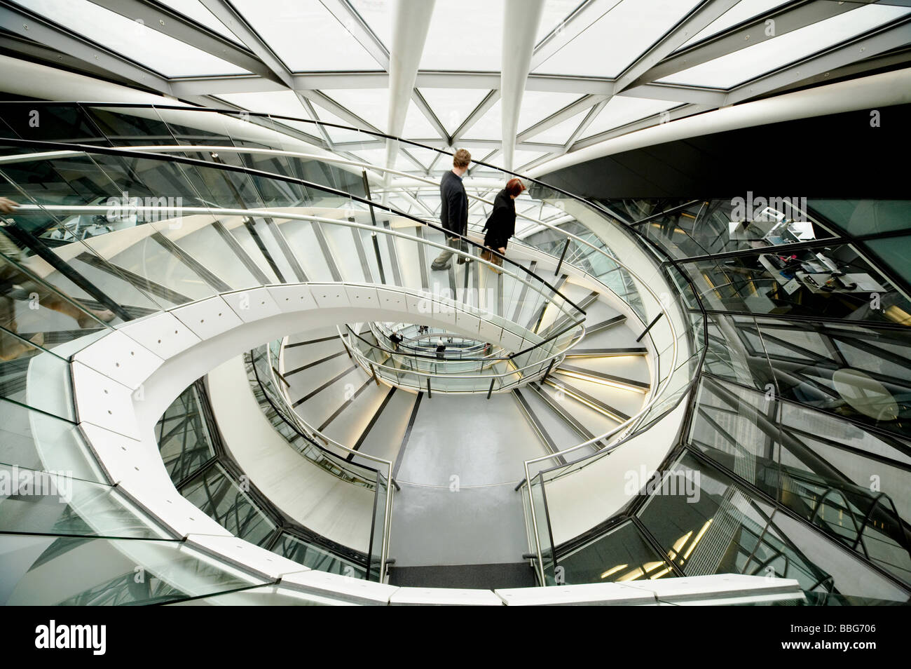 Interior atrium & Spiral staircase of GLA City Hall Mayors office Greater London Authority London England UK - Stock Image