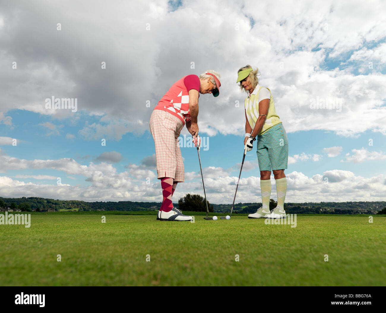 Mature ladies learning to playing golf Stock Photo
