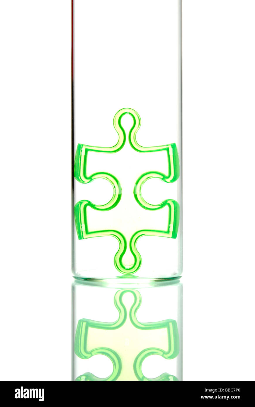 Jigsaw puzzle in a test tube, symbolic of analysis of an individual part - Stock Image
