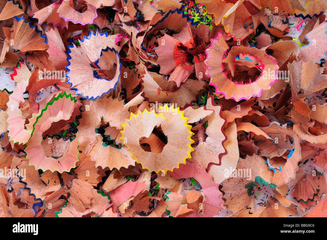 Clippings from the sharpening of coloured crayons - Stock Image