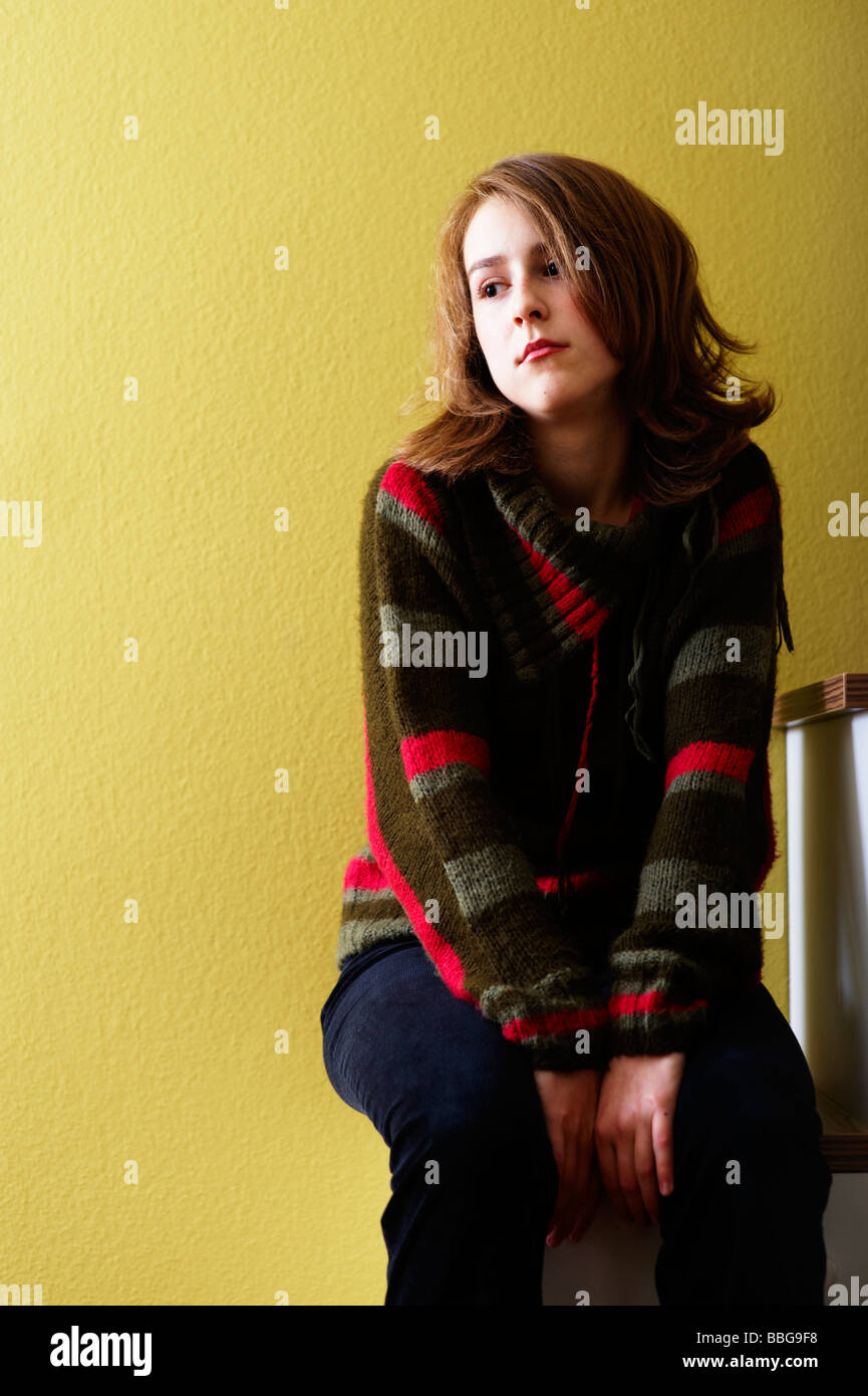 Young girl sitting on a step - Stock Image