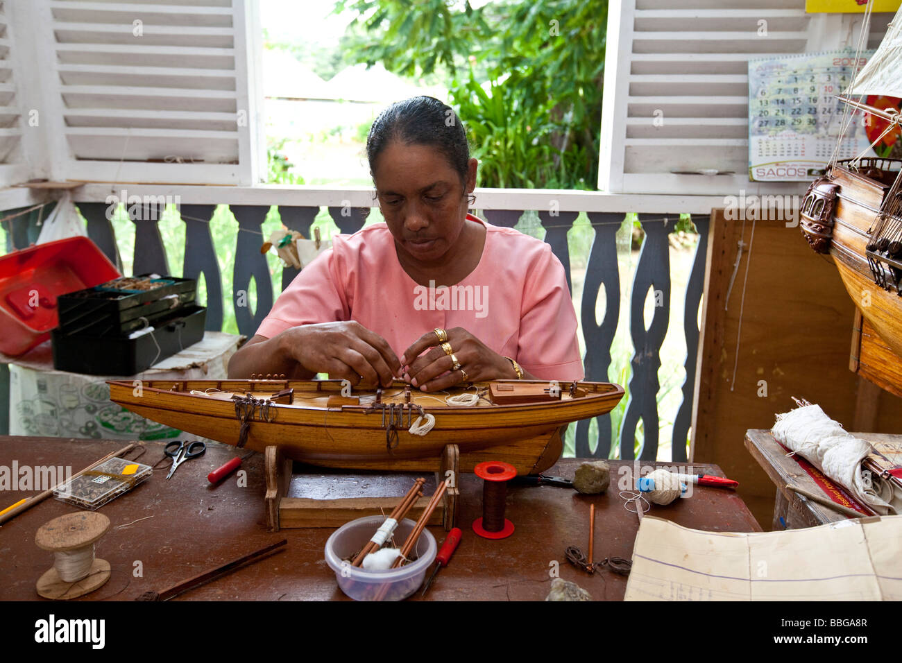 A Woman Making A Miniature Sailing Ship Craft Village Handicrafts