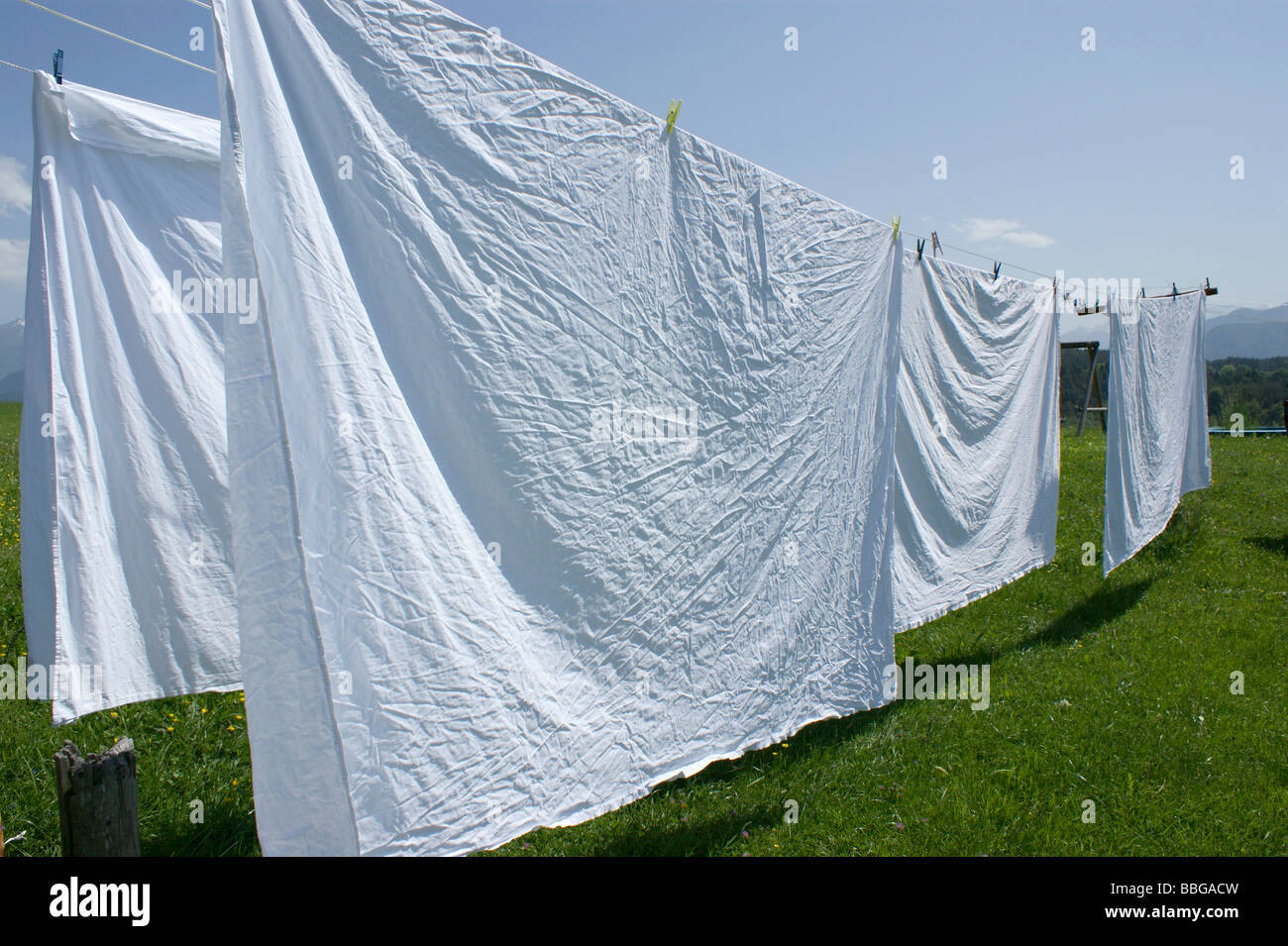clothesline with bed sheet - Stock Image