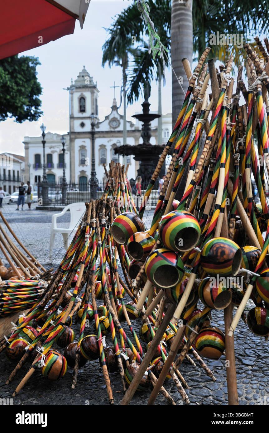 Traditional instrument Birimbao and church Igreja da Ordem Terceira de Sao Domingos at the Torreio de Jesus square, - Stock Image