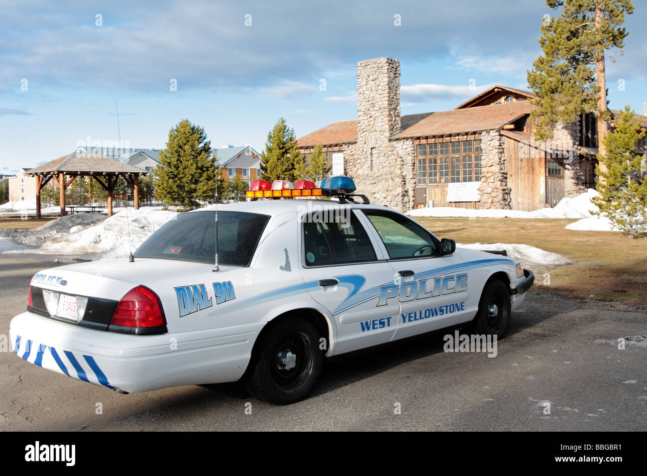 Police car parked in front of West Yellowstone Police Station in Montana USA - Stock Image