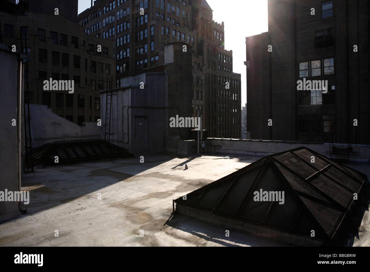 sunlight hitting New York rooftop - Stock Image