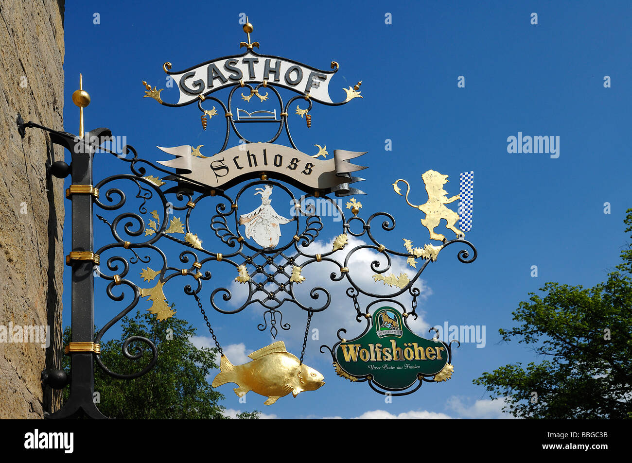 Decorative inn sign against blue sky, Eckental, Middle Franconia, Bavaria, Germany, Europe - Stock Image