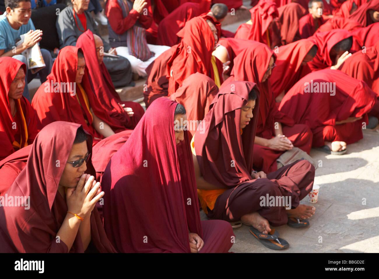 Buddhist Monks Hearing The Teachings Outside Sera Monastery Bylakuppe Koorg Karnataka India - Stock Image