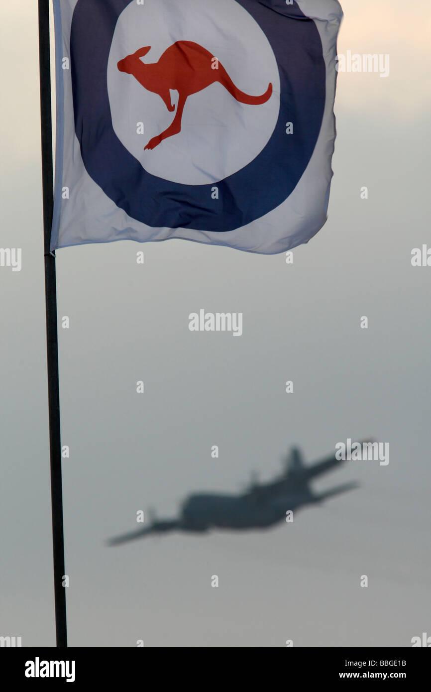 Lockheed C 130 Hercules and the RAAF Royal Australian Airforce Flag - Stock Image