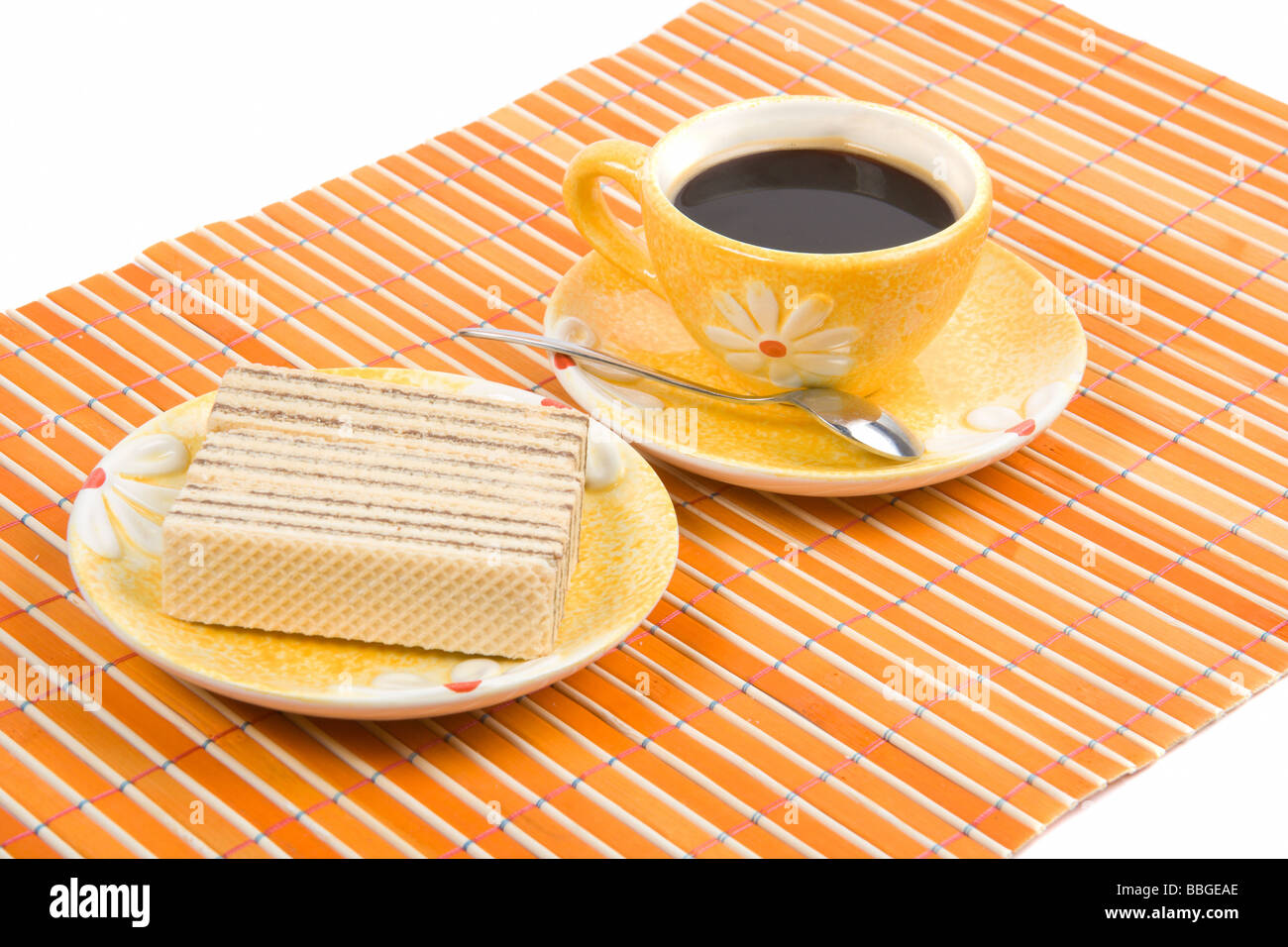 Close Up Waffle Slice And Cup With Cofee On Bamboo Table Cloth