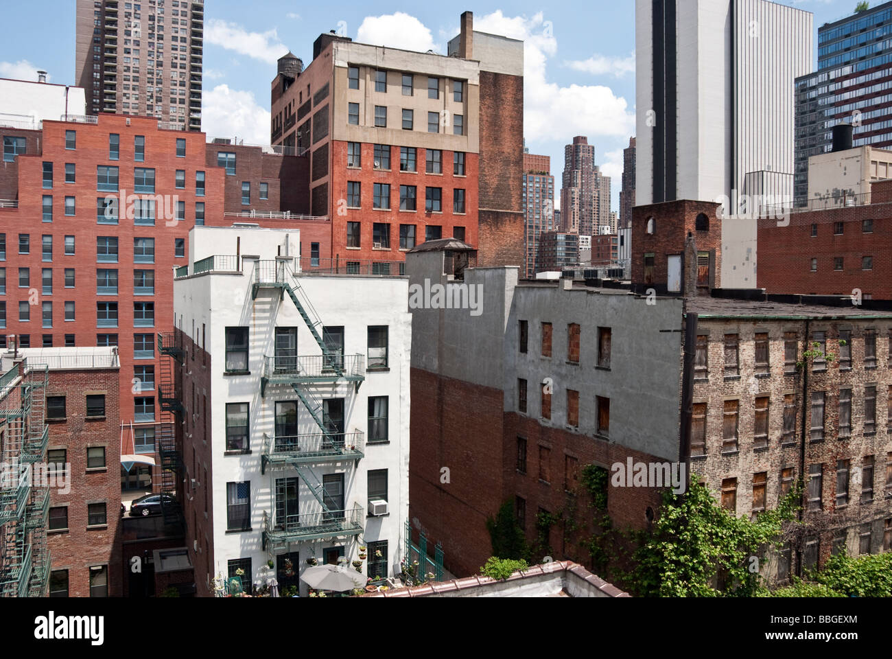 old, new & refurbished buildings seen against the rapidly changing skyline in Hells Kitchen, Manhattan, New York Stock Photo