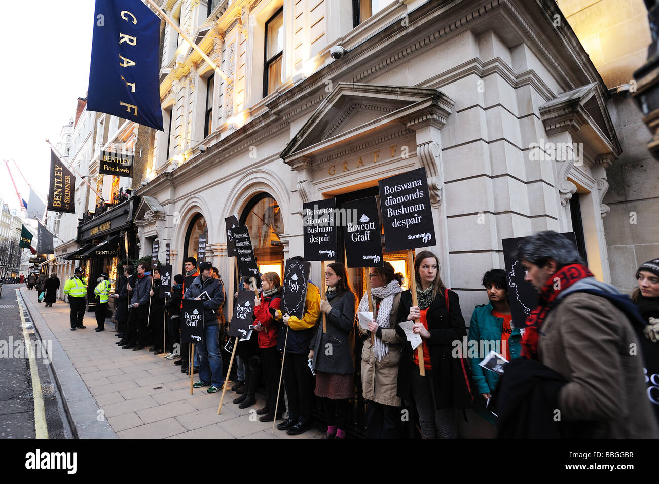 Survival International staging a protest outside the Graff shop in London's New Bond Street. - Stock Image