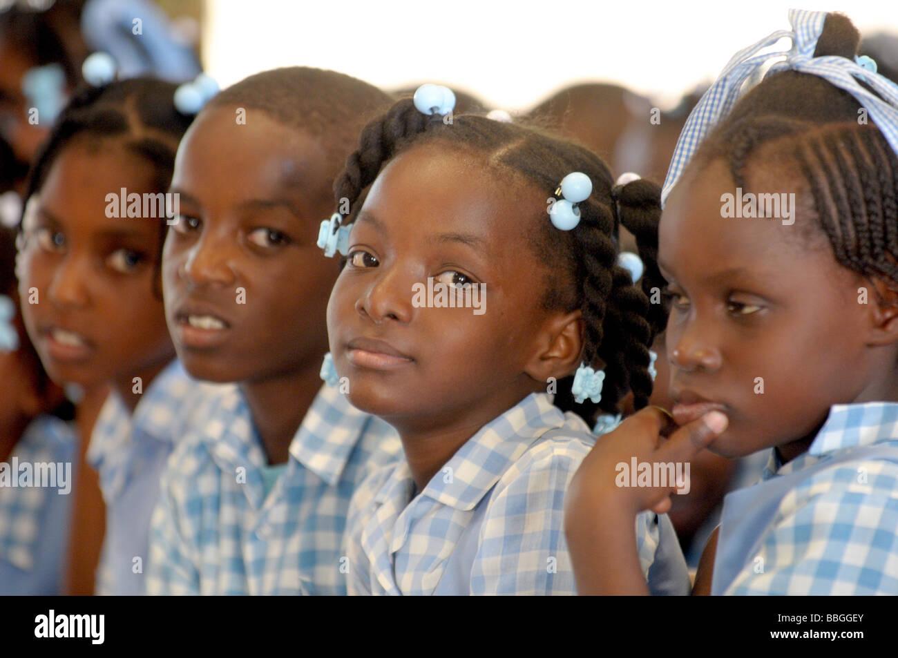 Group of beautiful black Haitian school children in blue school uniform - Stock Image