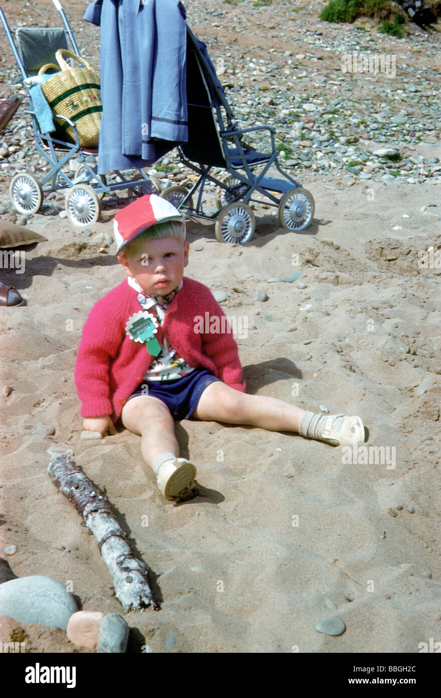 Colin Walton when a toddler on the beach at Butlins, Pwllheli, Wales. - Stock Image