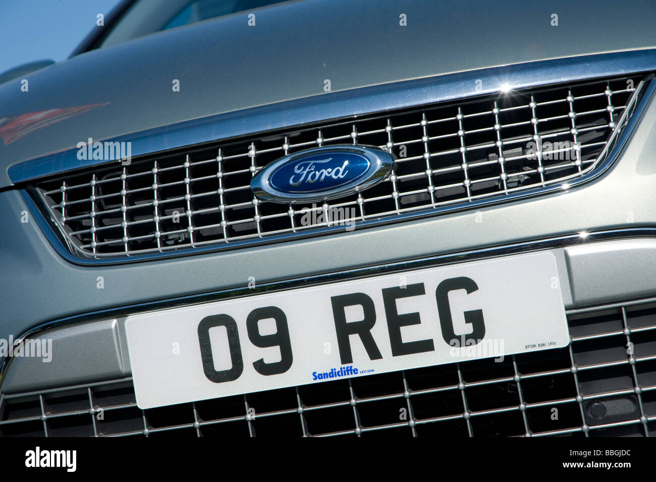 Close up detail of the front of a new ford car with a 2009 registration plate - Stock Image