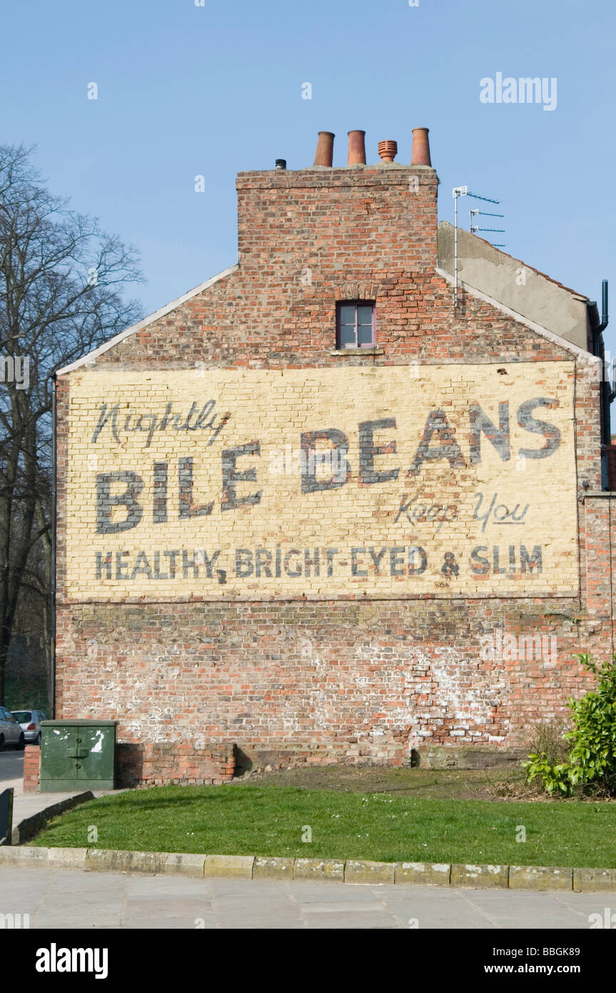 vintage advert advertising old fashion billboard painted bill board bile beans in york retro north yorkshire uk - Stock Image