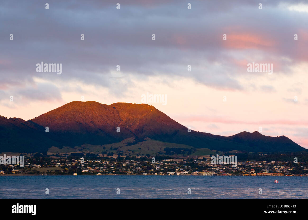 Evening light on Mountains Behind Taupo viewed from Acacia Bay North Island New Zealand Stock Photo