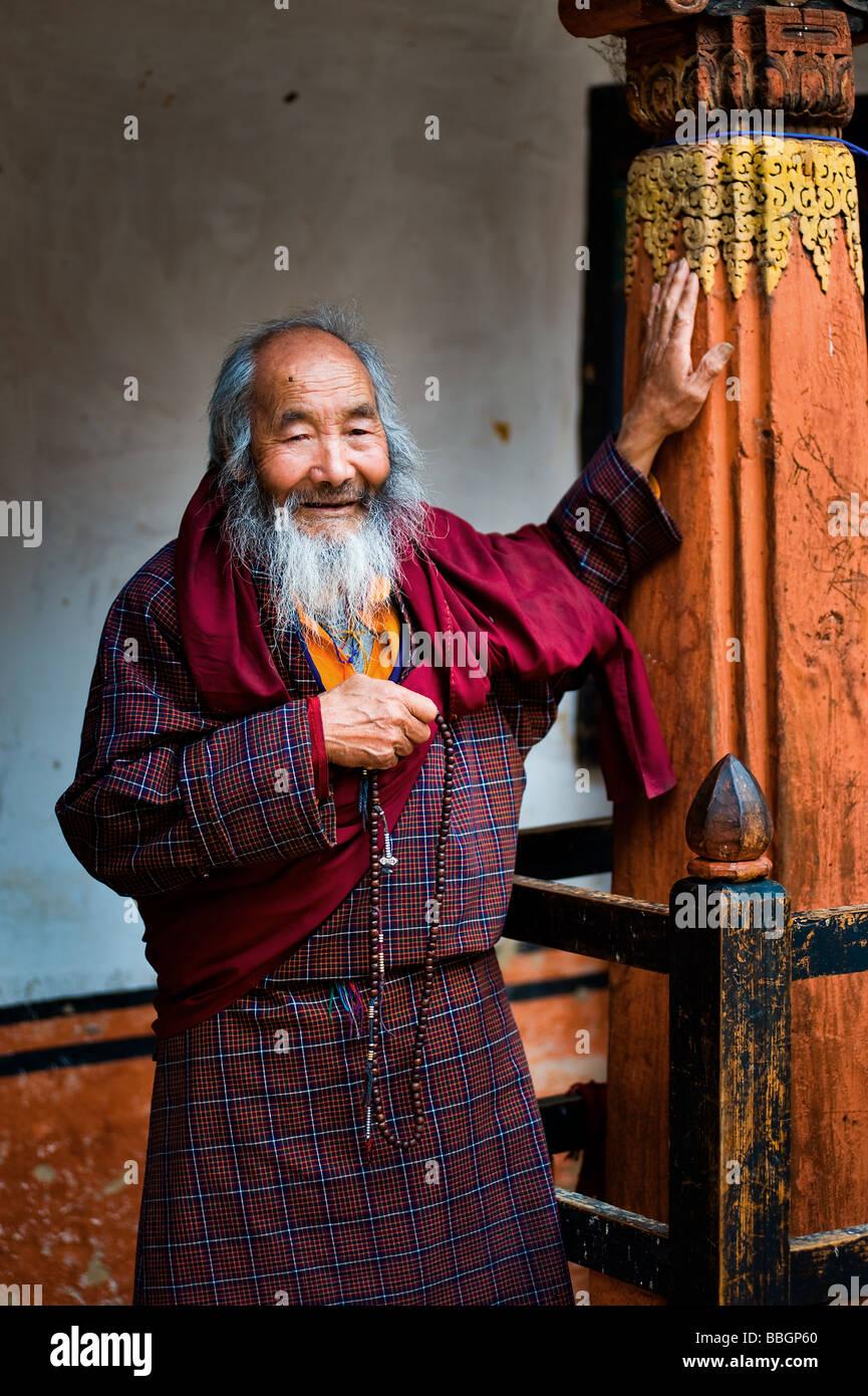 Portrait of an old monk - Bhutan - Stock Image