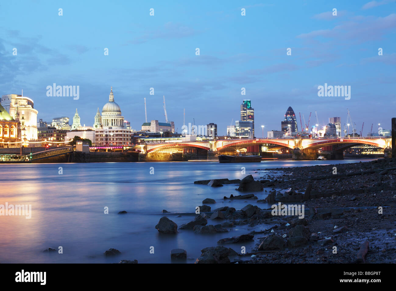 London skyline cityscape and River Thames at low tide in London England UK - Stock Image