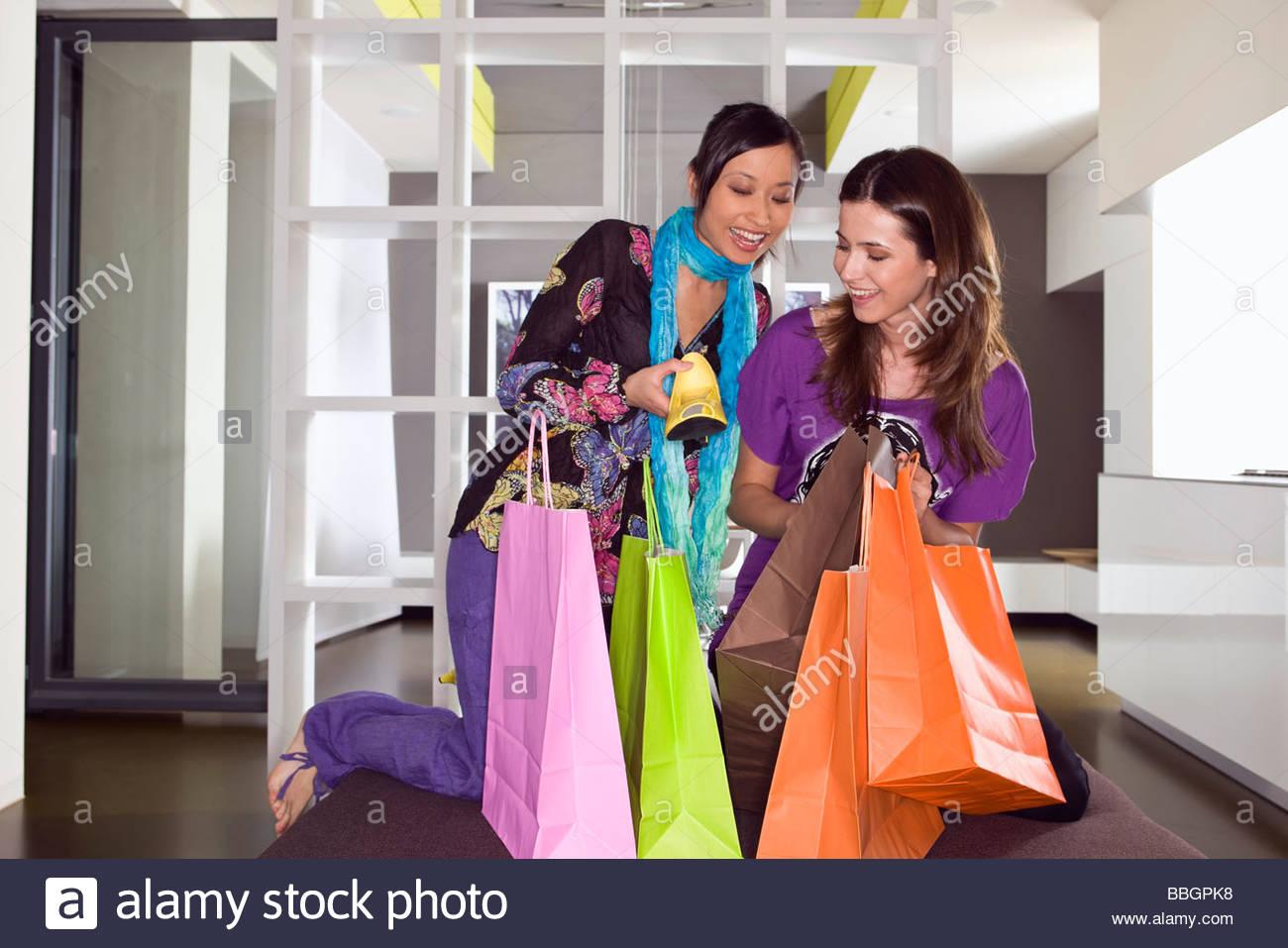 Young women shoe shopping - Stock Image
