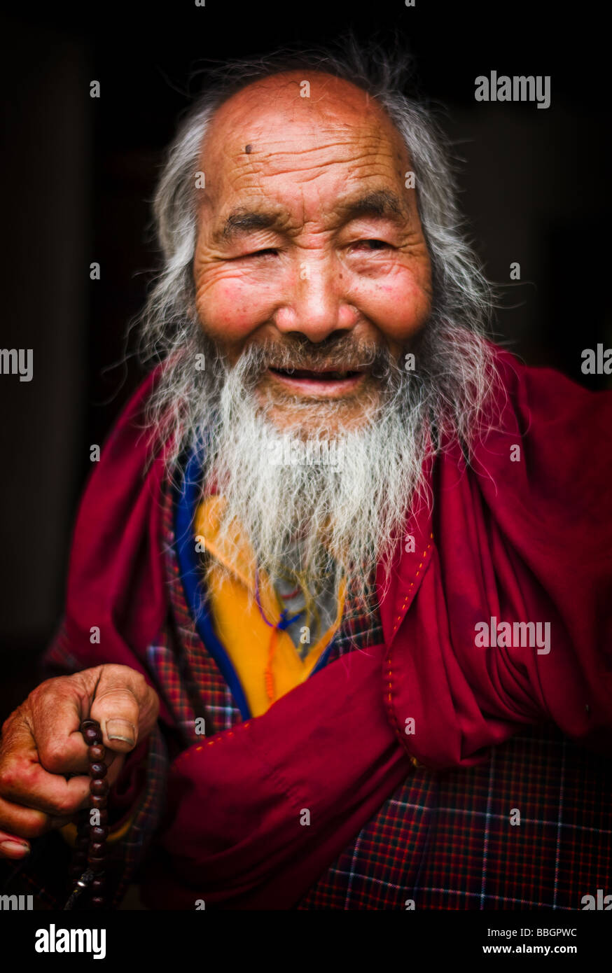 Portrait of an old monk - Bhutan - Stock Image