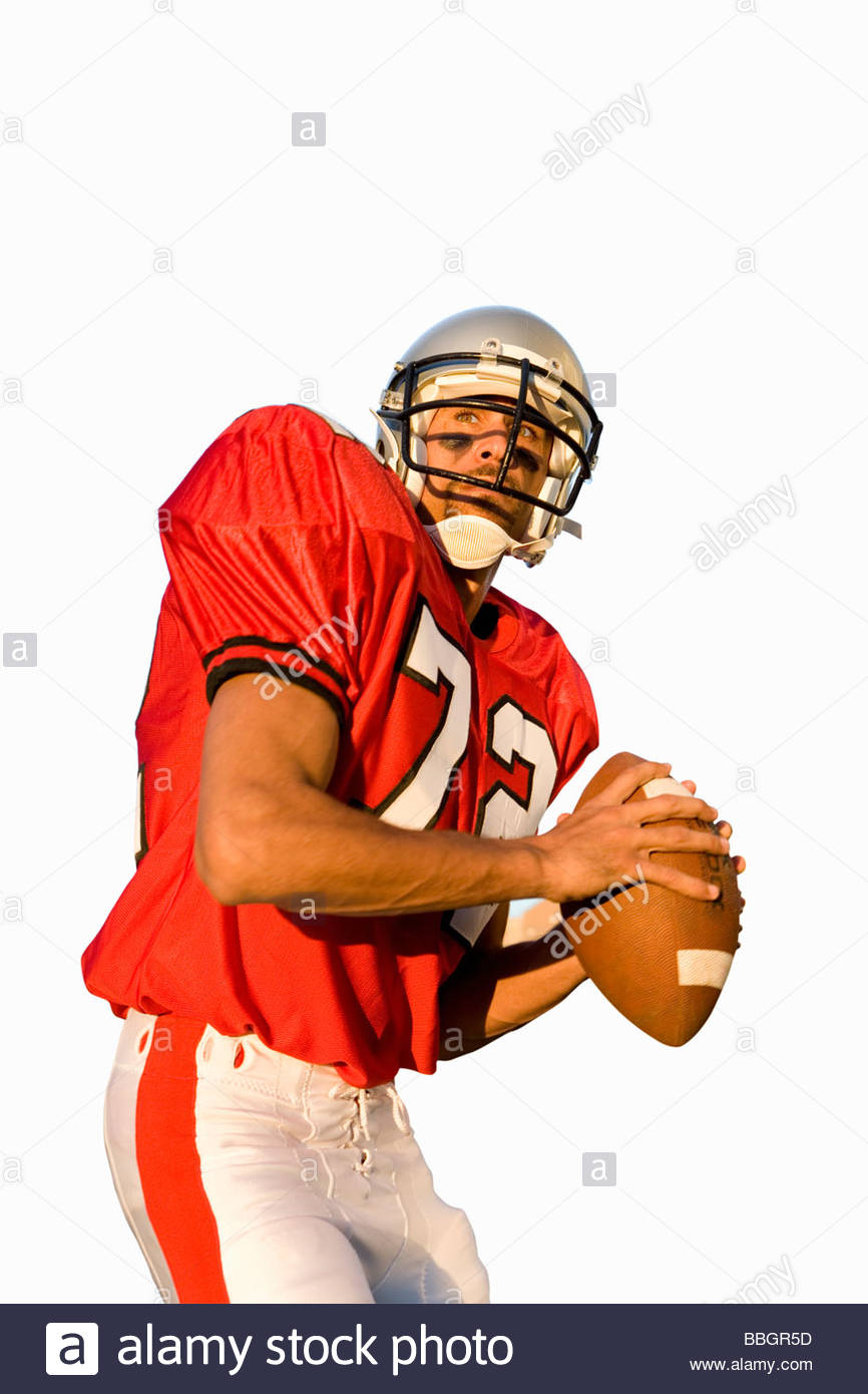 american football player holding american football, cut out - Stock Image