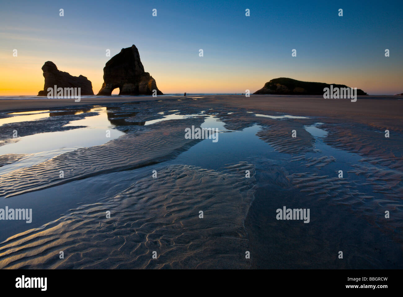 Rippled Sand and rock formations at Wharariki Beach Nelson South Island New Zealand Stock Photo