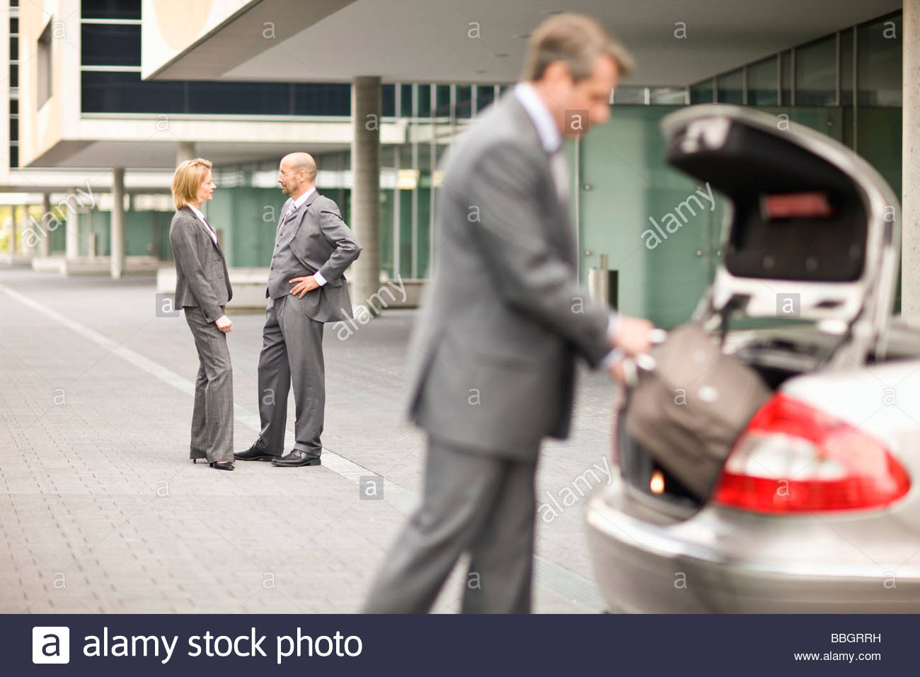 Two business colleagues having discussion outdoors Munich, Bavaria, Germany - Stock Image