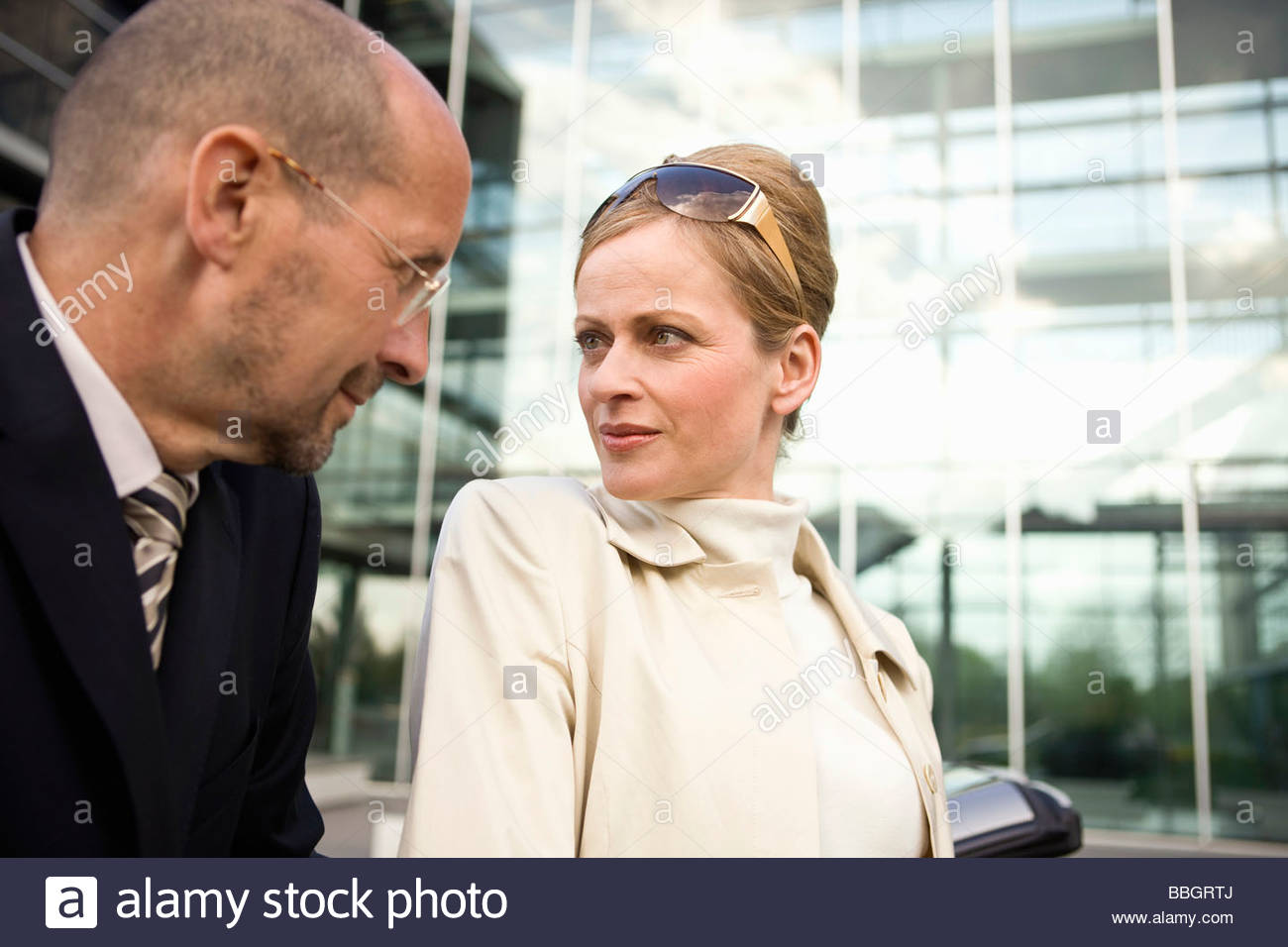 Mature adult couple urban scene looking at each other, Munich, Germany - Stock Image