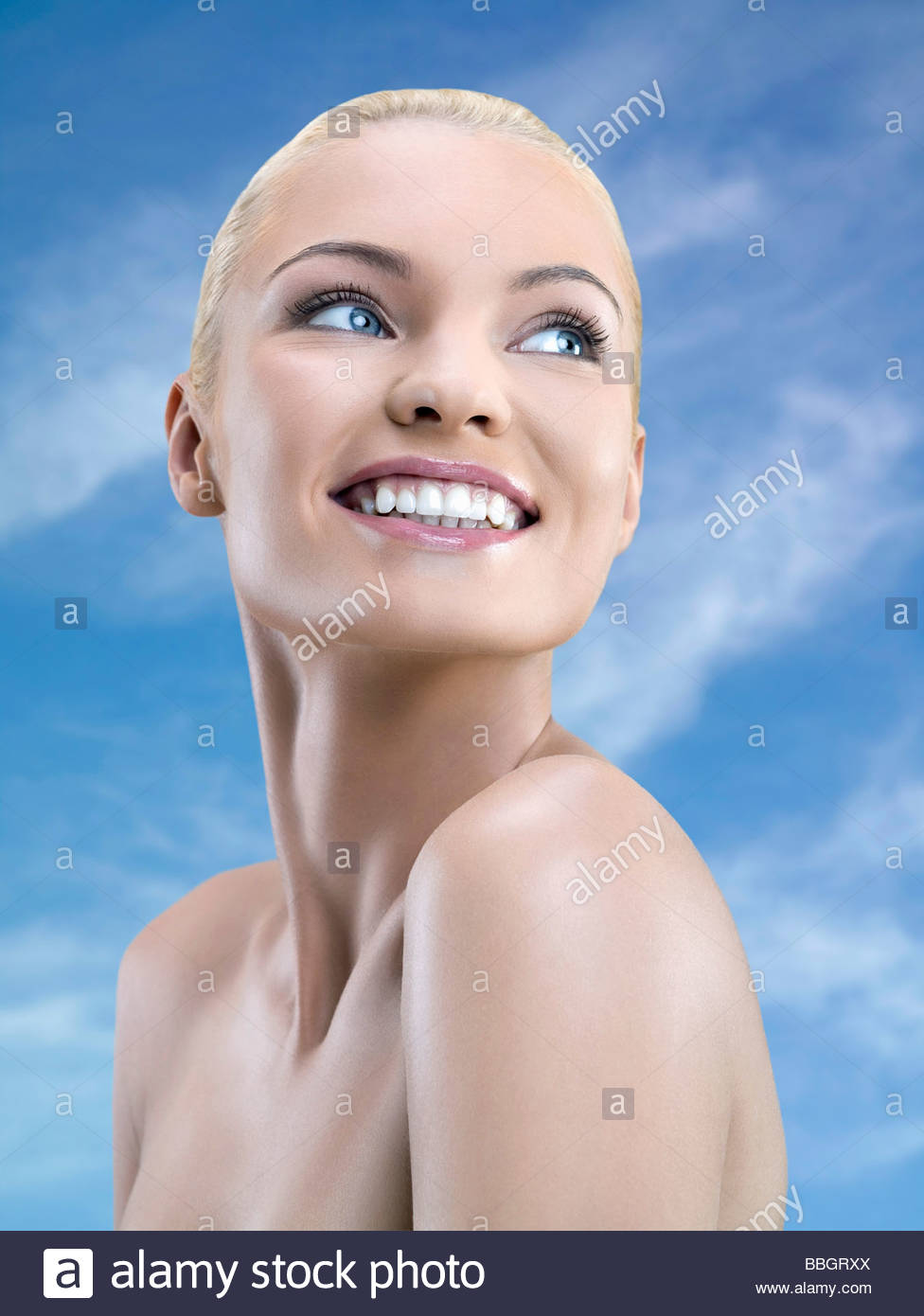 Portrait young adult woman, studio shot - Stock Image