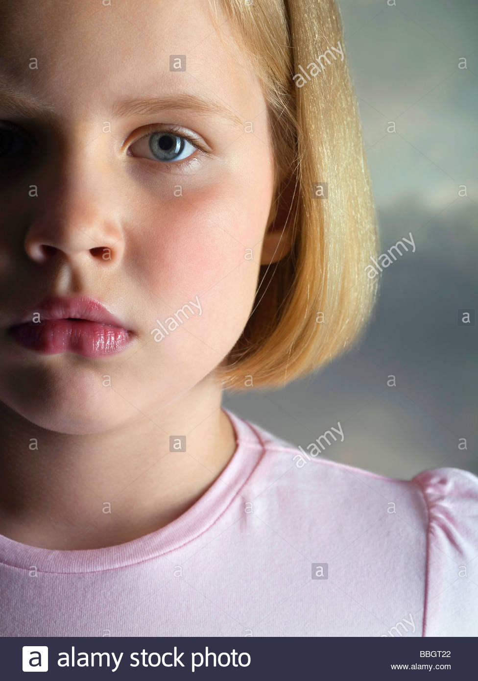 Portrait a sad young girl, studio shot - Stock Image