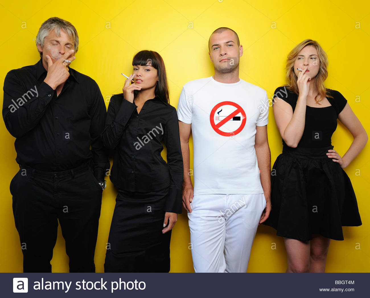 Non smoker surrounded by smokers, studio shot - Stock Image
