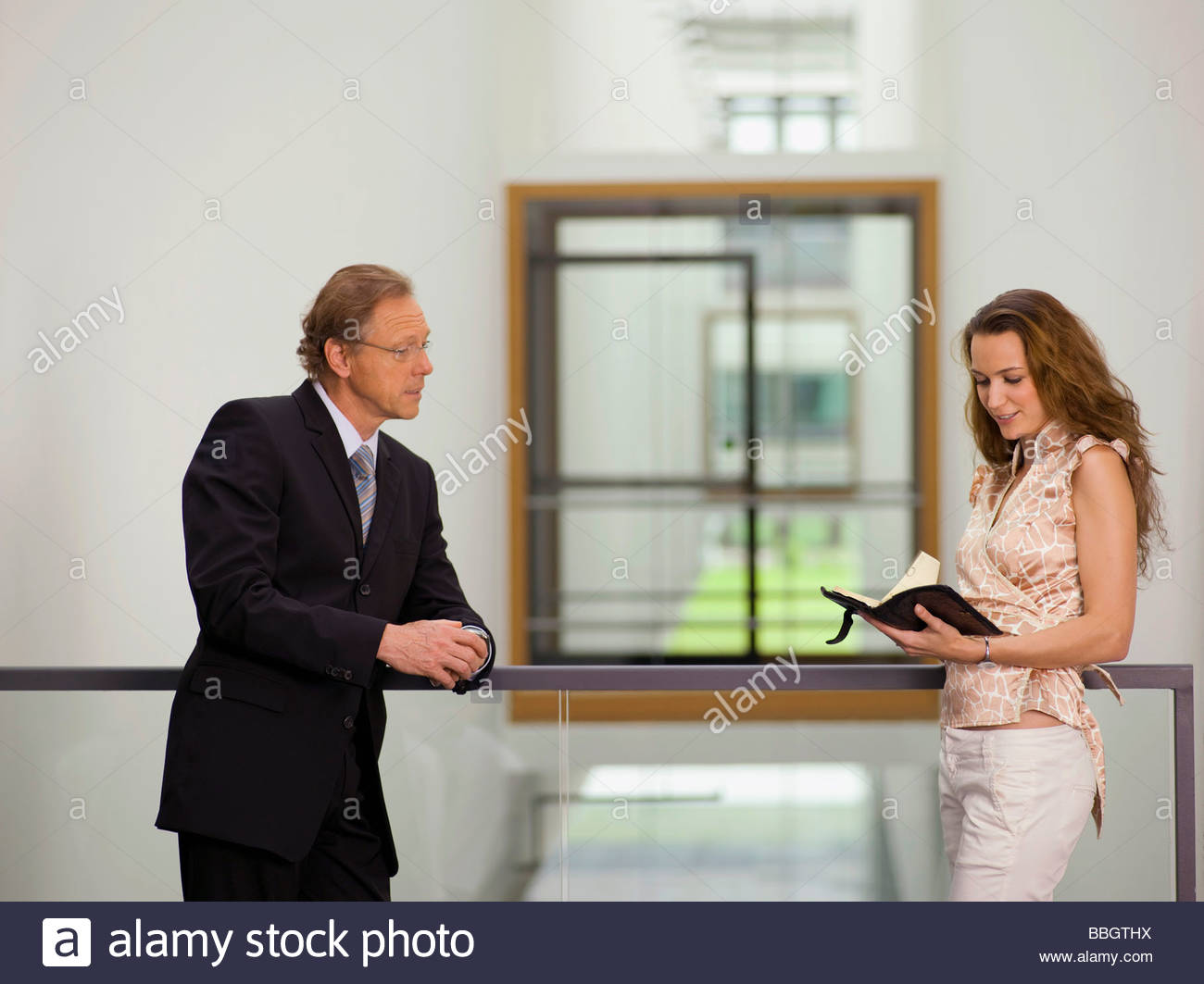 Businesspeople scheduling meeting - Stock Image