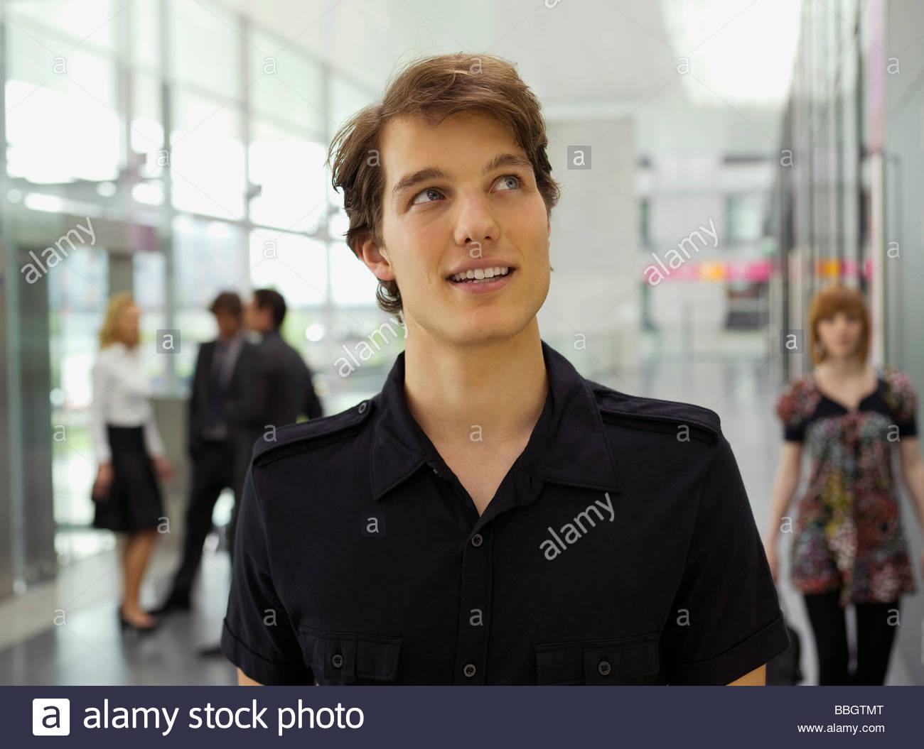 Stylish businessman looking up - Stock Image