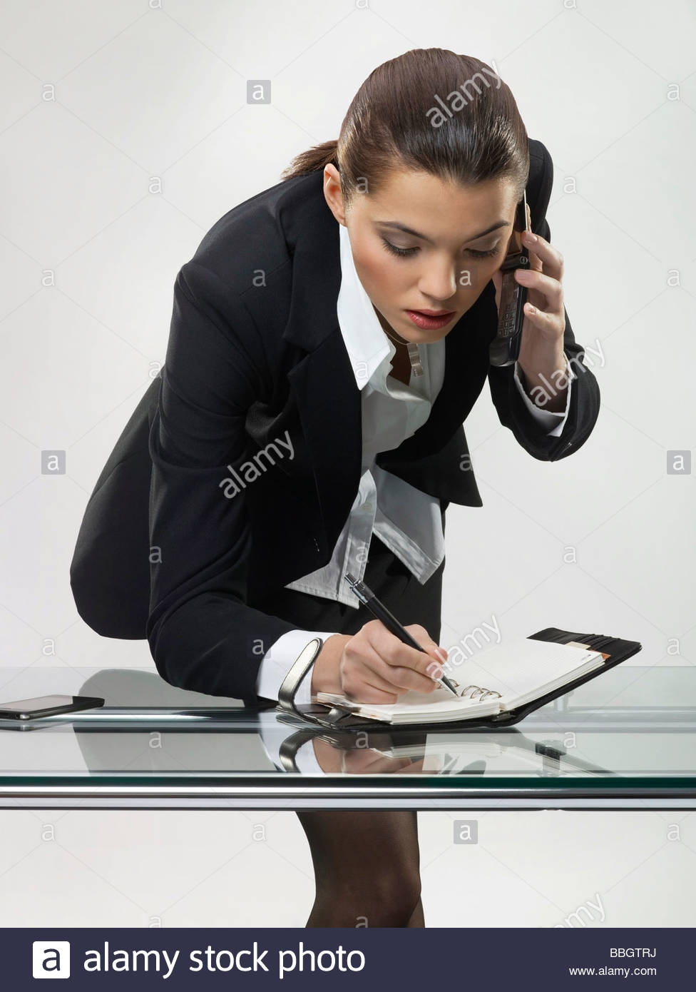 Businesswoman scheduling appointment - Stock Image