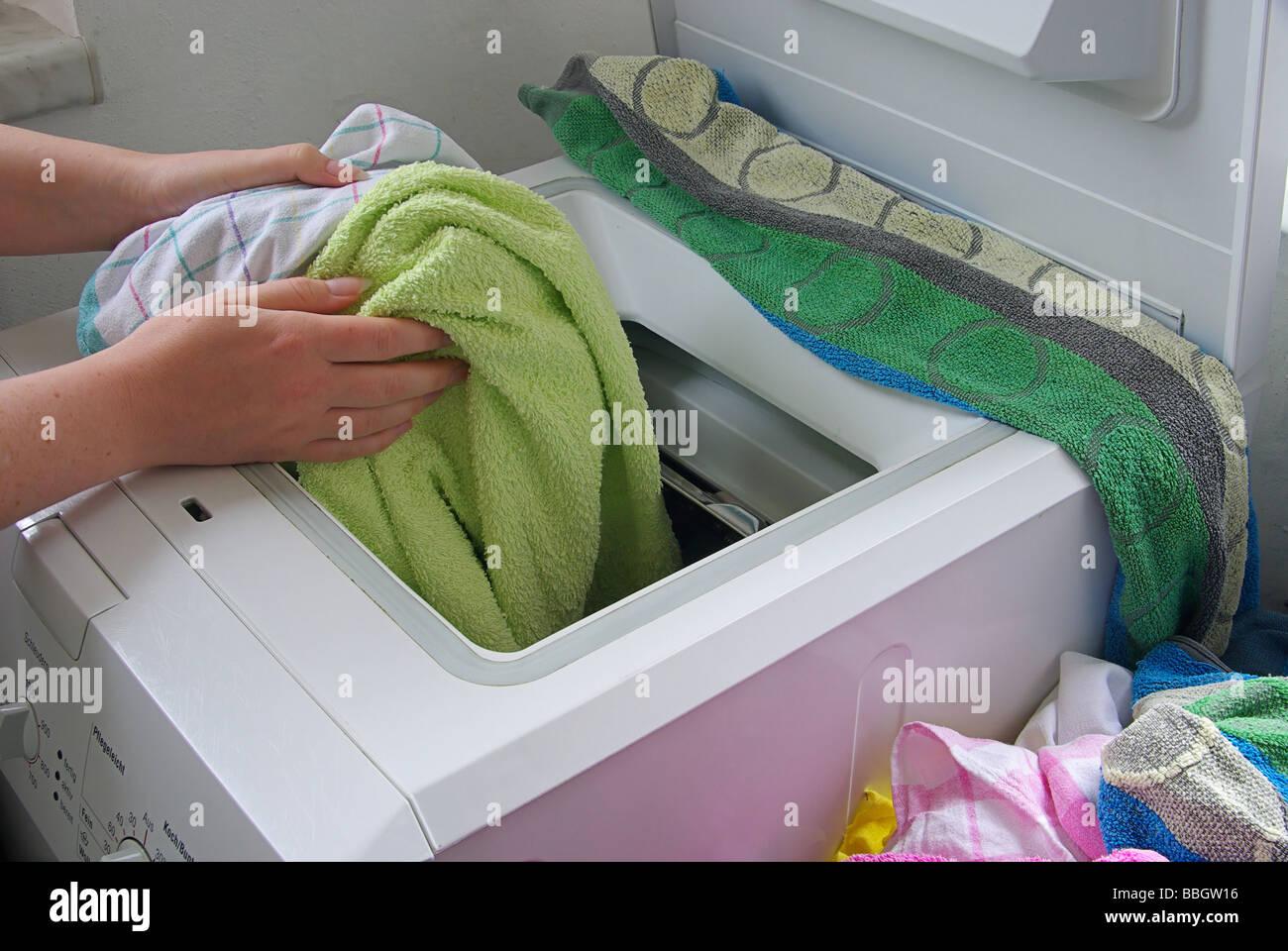 Wäsche waschen washing clothes 03 - Stock Image