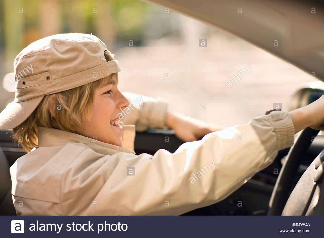Happy pre-adolescent boy sitting convertible, Munich, Germany - Stock Image