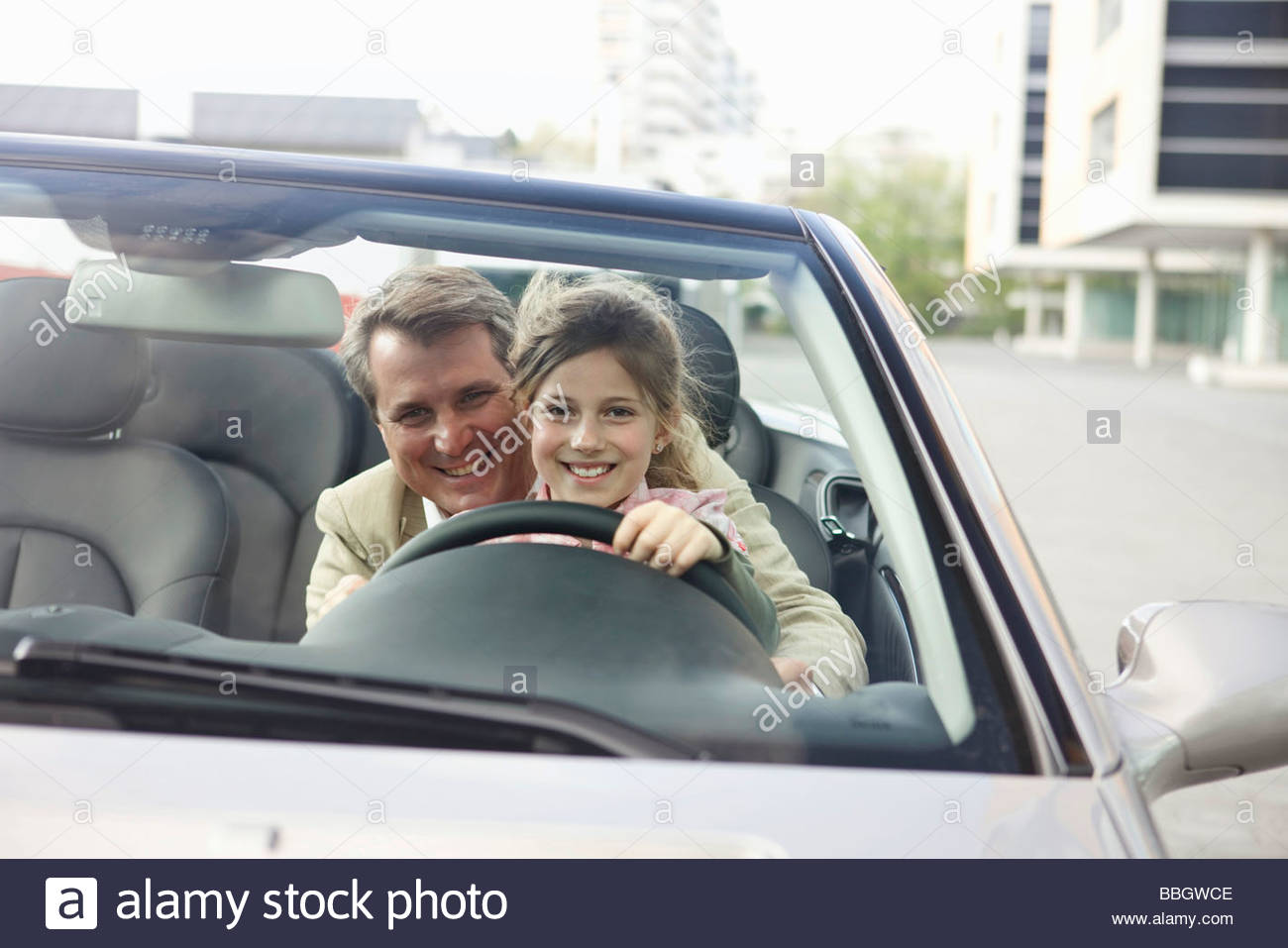 Father teaching daughter to drive car, Munich, Germany - Stock Image