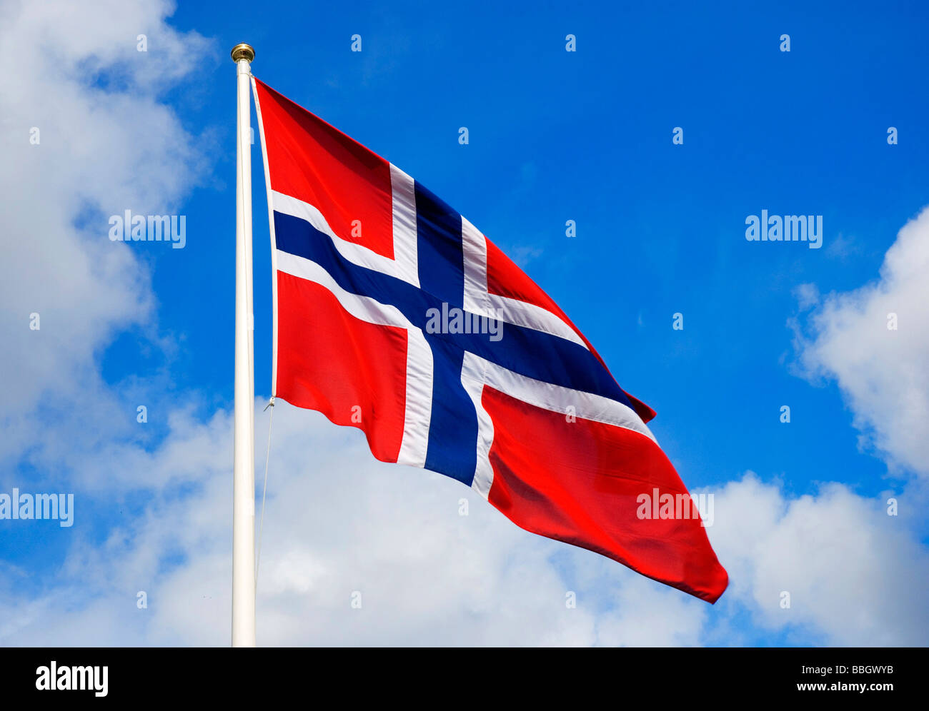 Norwegian flag floating in the wind during Norwegian national day celebrations in the beautiful town Bergen. (May Stock Photo