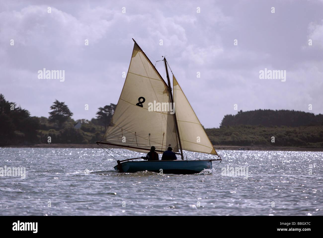 Small wooden sailboat, Golfe du Morbihan,  France - Stock Image