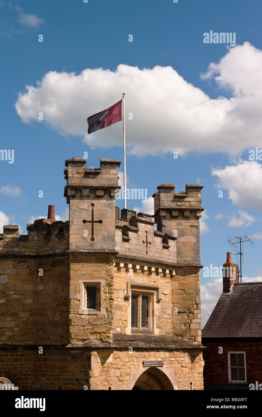 Turrets and flag on the old Gaol now Tourist Information Centre in Buckingham town England UK - Stock Image