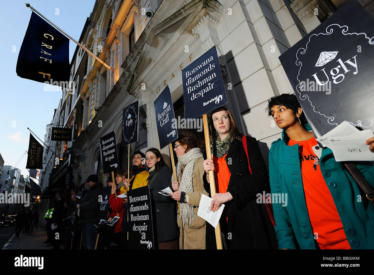 Survival International staging a protest outside the Graff shop in London's New Bond Street. Stock Photo