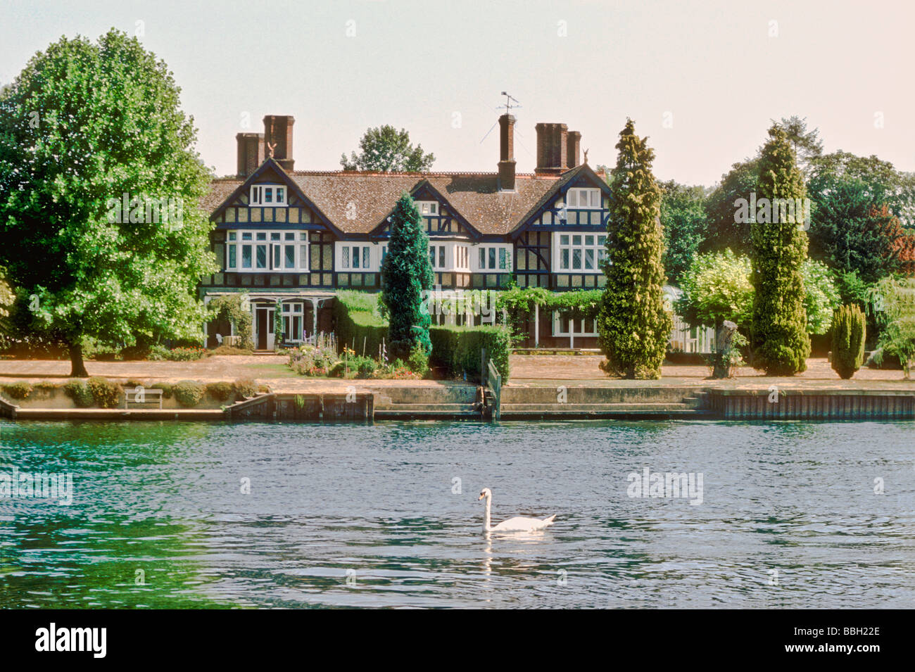 A large house on the River Thames at Remenham in Berkshire England UK Stock Photo